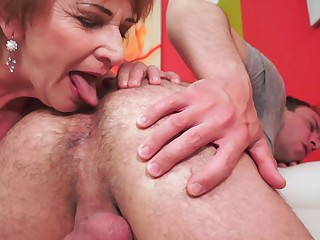 A fat elderly woman that loves to lick young dick is getting rammed