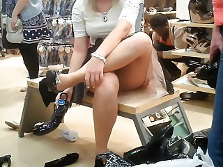 Blonde woman upskirtvoyeured in the hike store.