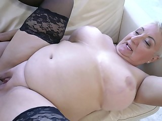 A fat nasty old girl has her large tits fucked well today
