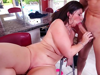 A big ass woman with huge bowels is sucking a big cock in this scene