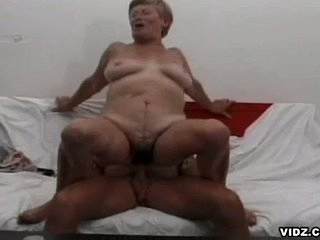 Nasty old granny enjoys enormous thick headed cock