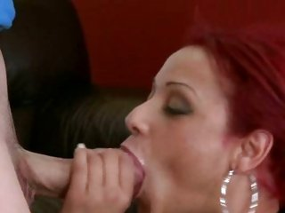 Raunchy redhead acquires her throat pressed with cock