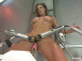 Large racked sporty brunette Ariel X is naked and enjoys mad sex with fucking machines. She acquires her her vagina dildoed and her clitoris double vibrated before that babe takes heavy fake cock in her ass.