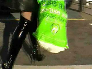 Shiney black boots with an increment of tights
