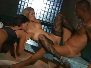 Blonde bitch and whorish brunette in stockings engulf hard schlong in threesome