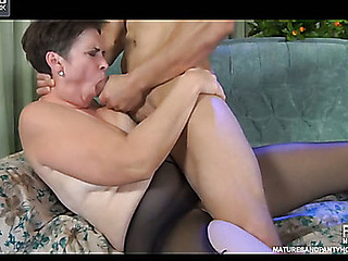 Muscle fellow wakes up a mature in black control top hose for a fuck session