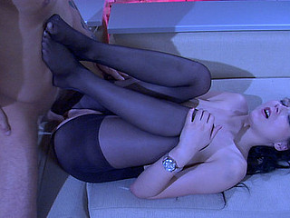 Lengthy-legged hottie milking a wang less her able feet in black nylon smalls