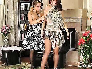 2 hawt gals wearing timeless maisonette hose checking their nyloned slits