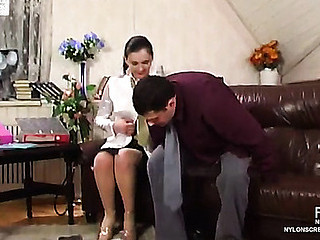 Sizzling sexy female co-worker in soft nylons doing her work in naughty way