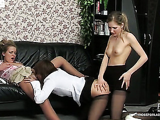 Three gals in lacy hose go for racy lesbo kisses increased by a strap-on fuck