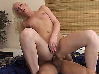 Filthy blonde t-girl eagerly swallowing a hard dick and booty riding her guy