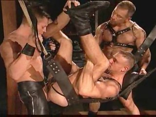 Gay leather guys having penetrating coitus