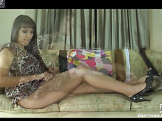 Darksome-haired sweetheart admires her legs and waist encased into sheer hose