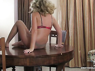 Heated blondie widening on the table in say no less recent sheer-to-waist hose
