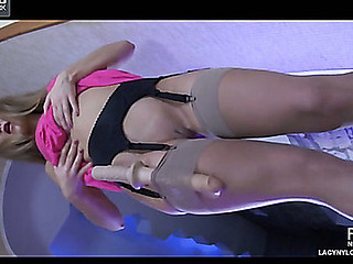 Sinistral wearing blondie spreads stockinged legs wide be expeditious for in the seventh heaven fake penis play