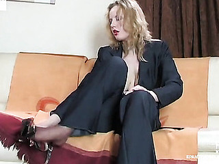 Raunchy business woman playing with her tan hose previous to taking 'em on