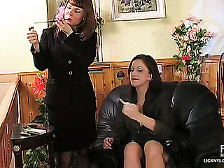Clad in black secretaries trying latest corsets and stockings for muff lapping