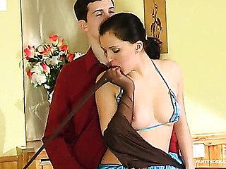 Upskirt gal teasing a guy with her silky hose and giving him a pantyhosejob