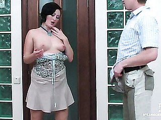 Smartly clothed brunette hair in barely visible nylons seducing a next-door chap
