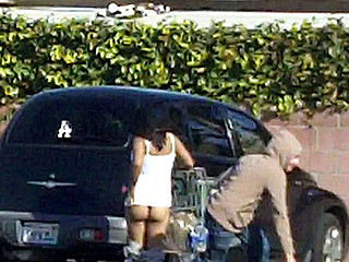 Pervert Pauper runs up and pulls some radom lady's shorts down in put emphasize supermarket parking lot...