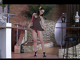 Nerdy maid admires their way legs in sheer pantyhose and tries on various high heels