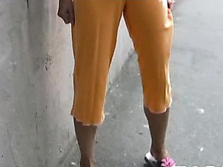 Cutie wets her sporty orange breeches