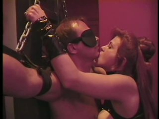 Evil Mistress Tara Pours Hot Wax On a Bound Submissive Male's Back