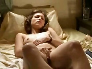 This captivating brunette masturbates herself to not one but two awesome climaxes with her fingers and we're not chatting about small orgasms. Her whole body spasms and jacks with sensation when she gets off.