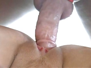 A rock hard jock keeps its boner with a tight cock ring and the lengthy haired GF loves it. She opens her vagina to the hardness that never fails and relaxes her mind out of worrying about the end.