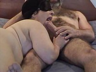 Masked chubby mature wife gives nice sucking and licking  to her hairy hubby\'s big dick - short but sweet