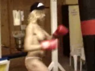 Nearly nude blonde boxing