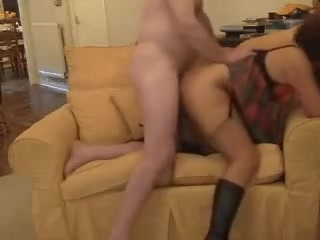 With petticoat and boots on, my wife lies on the couch. I place myself between her legs and lick her cunt. Then, I make her stand on her knees and fuck her form behind. She exchanges a oral pleasure for facial.