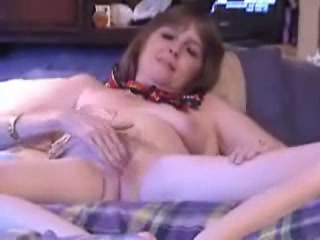 Adult graceful housewife is caressing her smooth shaved kitty, loosing her head in hot waves of great climaxes.