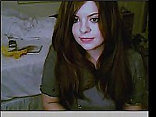 Very young teen posing in front of her webcam.