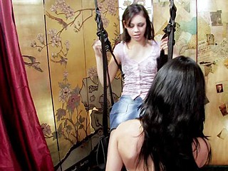 2 brunette lesbo women play on a sex chair and toy pussy