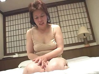 Married superannuated Asian granny is blindfolded as A this babe masturbates her censored pussy