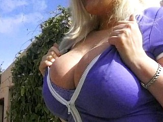 Chubby aged blonde does a photo shot outdoors and fucks the photographer