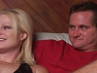 Blond housewife arms herself with a strap-on and bonks her boyfriend in the ass