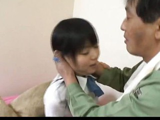 Minami Asaka Lovely Asian schoolgirl plays with her large vegetables