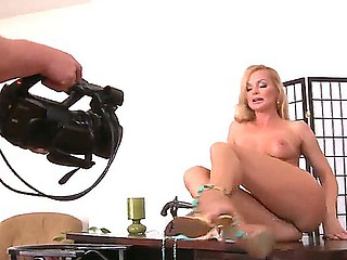 Silvia Saint is posing totally naked, showing her charming boobies and mean cum-hole