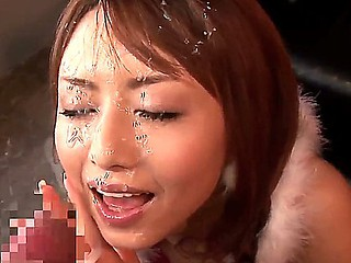 Akiho Yoshizawa is one sexy oriental wich gets filled with cream after deep engulfing a huge weenie