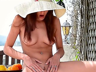 Redhead with sweet bald pussy Candice Luca enjoys valuable outdoor solo session