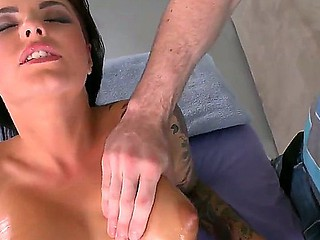 Naughty babe Christy Mack receives a hot massage and demonstrates her sweet oiled body