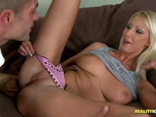 Pretty blond Pamela in pink pants offers her pussy