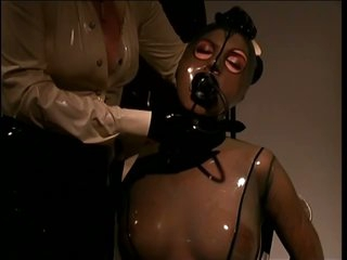 Slave Gal Wrapped In Skintight Latex