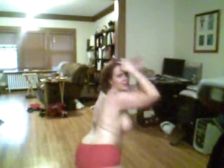Fat sweeping dancing in costume and stripping