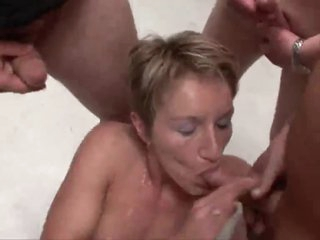 Pierced and tattooed blonde gangbang slut
