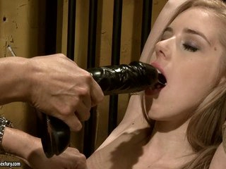 Mandy Bright power a blonde babe to blow a dildo