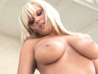 Blond Sheila Grant with giant scoops strips outdoors