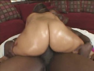 The oil above her ass makes her ergo fuckable